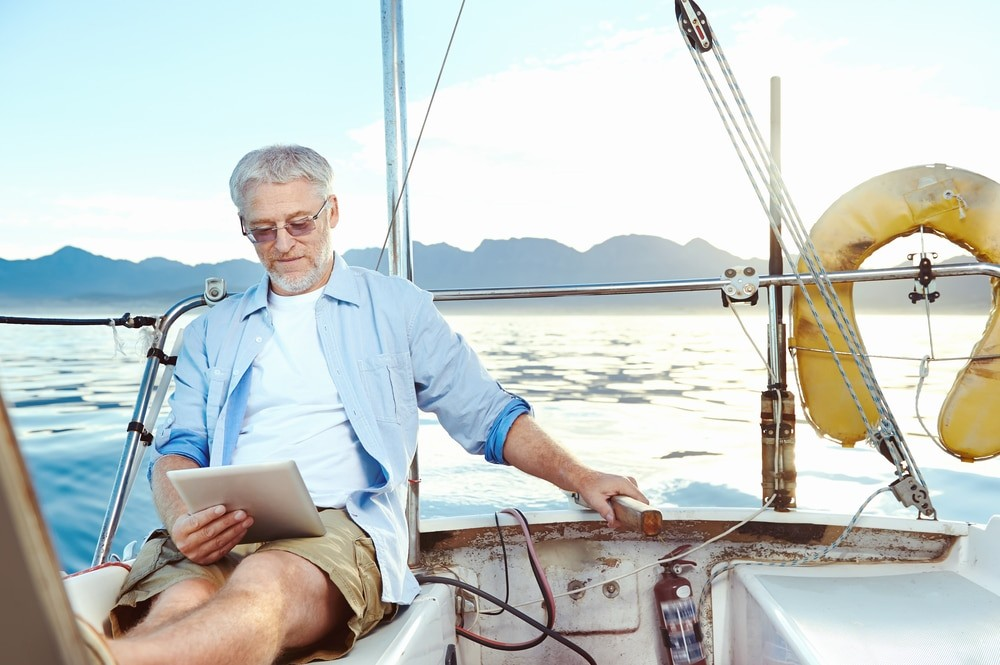 Retired Man Reading Tablet